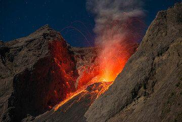 Strombolian eruption in moonlight. (Photo: Tom Pfeiffer)