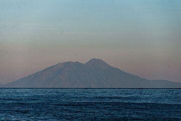 Ile Api (Lewotolo) volcano on Lembata island is seen in the east. (Photo: Tom Pfeiffer)