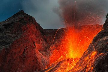 During our Batu Tara volcano expedition we stayed on the island from 30 June - 4 July 2015 and found the volcano in similar activity (strombolian) as during our other visits in Nov 2012 and 2014. However, during the night 2-3 July and early on 3 July, a phase of increased activity resulted in the formation of small pyroclastic flows caused by collapsing material ejected during the explosion and/or accumulated on the crater rim. See also: Expedition, camp & volcano | Video clips of eruptions (Photo: Tom Pfeiffer)