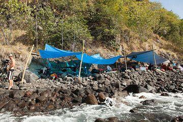 Camp on the rocky beach of Batu Tara (Photo: Tom Pfeiffer)