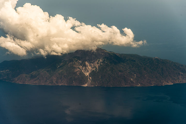 View of Paluweh island with the still fresh pyroclastic deposits from the 2012-13 eruption on the central southern side. (Photo: Tom Pfeiffer)