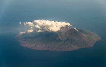 Active Sangeangapi island volcano with a gas plume visible drifting west. (Photo: Tom Pfeiffer)