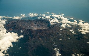 The mightly caldera of Tambora volcano - the site of the largest known historic volcanic explosion in the world: the volcano was decapitated during its violent explosion in 1815. (Photo: Tom Pfeiffer)
