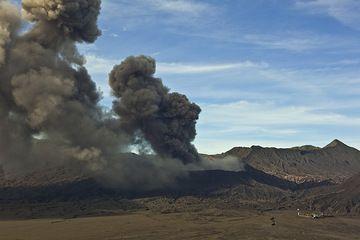 Erupting Bromo volcano seen from Cemoro Lawang village on the caldera rim during 16 Feb. (Photo: Tom Pfeiffer)