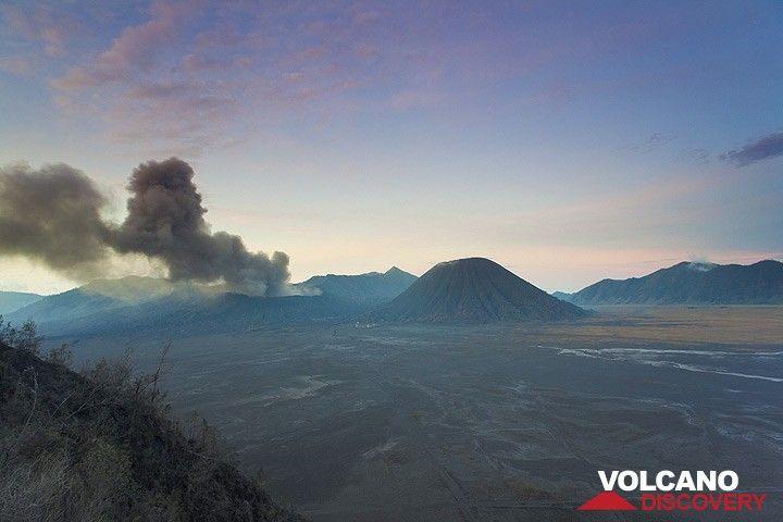Bromo emitting dense ash clouds seen at dawn from the caldera rim (Photo: Tom Pfeiffer)