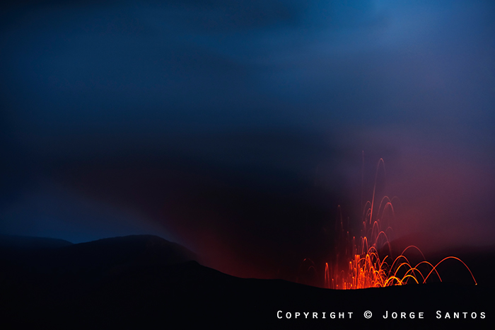 Glow and an eruption from Bromo volcano at dawn (Photo: Jorge Santos)