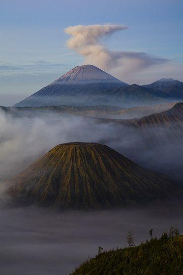 Semeru volcano towering over the gullied cone of Batok  (c)