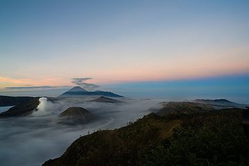 View towards the SW over the caldera. The earth`s shadow is in the sky. (c)
