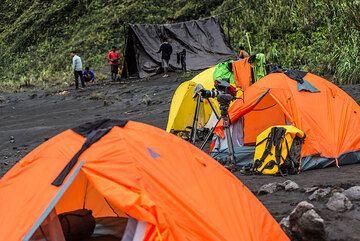 Setting up camp at Dukono volcano. (Photo: Tom Pfeiffer)