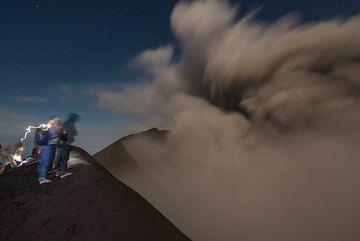 Group at the rim of Dukono volcano at night. (Photo: Tom Pfeiffer)