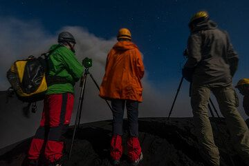 Observing Dukono's activity from the crater rim. (Photo: Tom Pfeiffer)