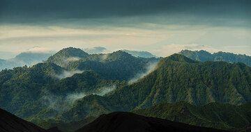 Eroded volcanic cones in the morning mist. (Photo: Tom Pfeiffer)