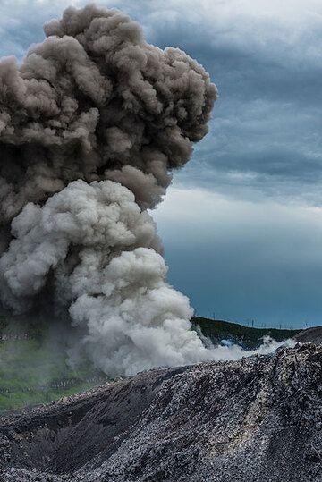 Small mushroom ash cloud rising from Ibu's vent. (Photo: Tom Pfeiffer)