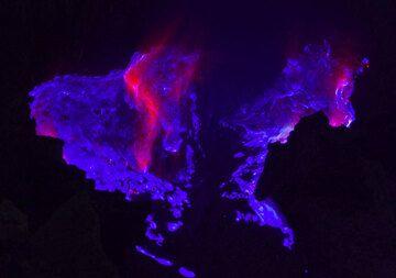 Blue flames of burning sulfur inside Kawah Ijen volcano, East Java (Photo: Andi Rosadi)
