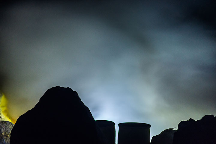 Somebody with a strong white headlamp illuminates the scene behind the silhouetted blocks and cylinders. (Photo: Tom Pfeiffer)