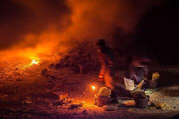 The torches cast a wonderful orange light on the whole scene. (Photo: Tom Pfeiffer)