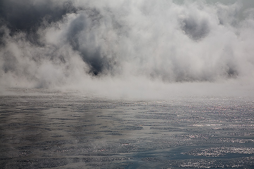 Steam above the mud lake (Photo: Tom Pfeiffer)