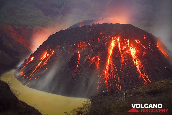 Muddy brown color of the remnant of the lake, now largely replaced by the active growing lava dome (Kelut volcano, East Java, Indonesia). (Photo: Tom Pfeiffer)