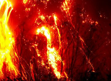 Glowing lava avalanches from the active lava dome of Kelud volcano (East Java, Indonesia) during its Nov 2007 eruption. (c)