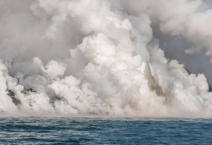 Sometimes, the explosions generate small dark jets of steam mixed with rock debris. (Photo: Tom Pfeiffer)