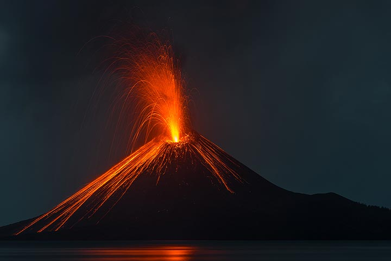 Typical strombolian eruption seen from the beach of Rakata. (Photo: Tom Pfeiffer)