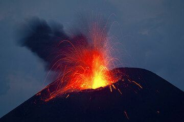 Strombolian eruption at dawn. (Photo: Tom Pfeiffer)