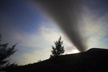 Ash plume drifting over us against a full-moon lit sky. (Photo: Tom Pfeiffer)