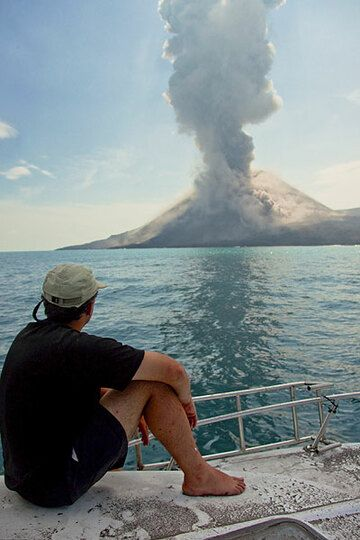 While it's raining ash from the explosion that just passed, another, smaller explosion takes place. it was typical to observe a series of weakening explosions after the first powerful blasts. Probably, this can be interpreted by downward progression of explosive pressure release inside the conduit. (Photo: Tom Pfeiffer)