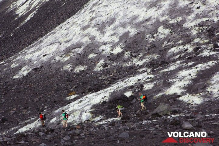 Our group walking on white altered ground at the foot of the cone of Anak Krakatau (Photo: Tom Pfeiffer)