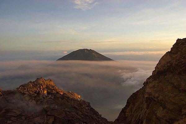 Neighboring Merbatu volcano  seen from the top of Merapi    (Photo: Tom Pfeiffer)