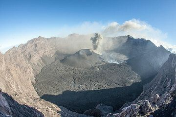 With a small group we climbed Raung during 14-15 August 2015. The hike involves approx. 20 km trekking and almost 2000 m climbing along a mostly overgrown path as only few people visit this spectacular volcano, even though it is one of Indonesia's most active ones.  We might have witnessed the end of the large 2015 summit eruption, which during June-early August produced large lava flows, lava fountains and significant ash plumes.  (Photo: Tom Pfeiffer)