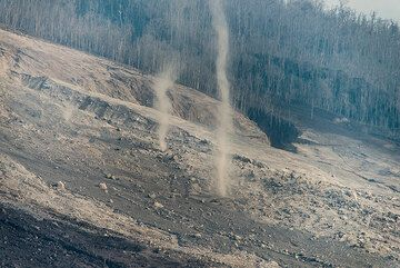 Hot dust devils rise like tornados from the fresh and still hot pyroclastic deposits. (Photo: Tom Pfeiffer)