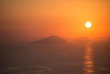 Sunset behind Filicudi (l) and Alicudi (r) islands. (Photo: Tom Pfeiffer)