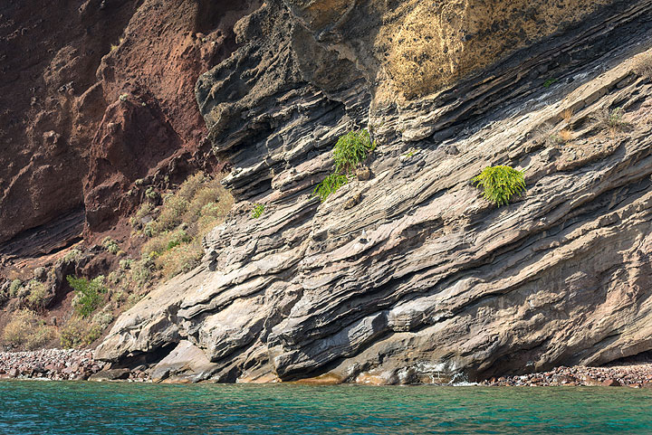 Ash and scoria layers of Monte Rosa exposed in the cliff between Canneto and Lipari (Photo: Tom Pfeiffer)
