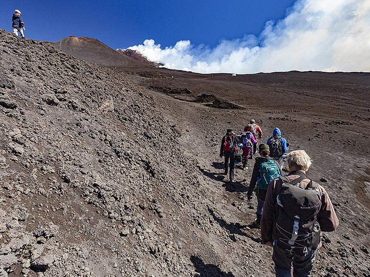 The VolcanoAdventures group near the recent eruption site of Etna in May 2019. (Photo: Tobias Schorr)