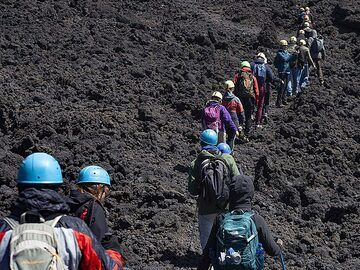 The visitors hike closer to the May 2019 eruption on Etna volcano. (Photo: Tobias Schorr)