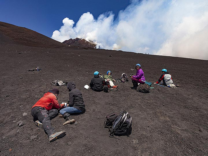 The VolcanoAdventures group relaxing at Etna. (Photo: Tobias Schorr)