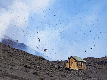 Big pieces of hot lava are thrown out from the fissure eruption in May 2019 at Etna volcano. (Photo: Tobias Schorr)