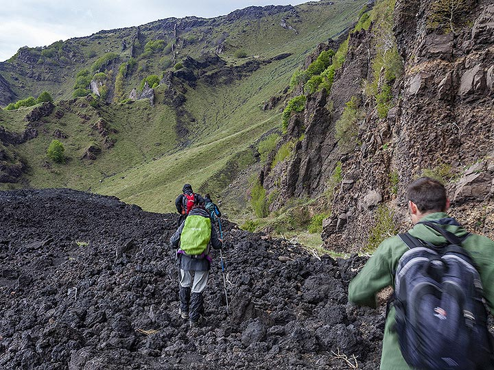 The VolcanoAdventures group hiking over old lava flows in the Valle del Bove. (Photo: Tobias Schorr)