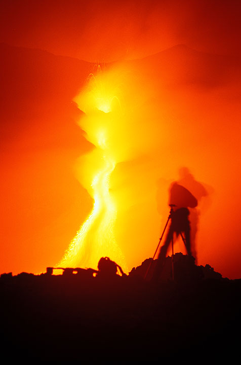 Photographer in front of the lava flow from the 2100 m vent. (Photo: Tom Pfeiffer)