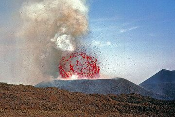 A perfect lava bubble, about 40 m across explodes inside the new crater. (Photo: Tom Pfeiffer)