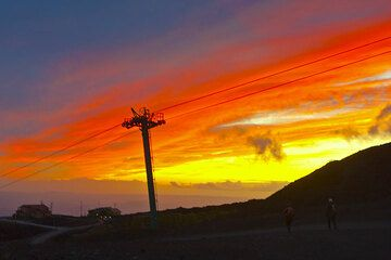 Silhouette of a pylon of the cable car of Etna against the dusk sky.  (Photo: Tom Pfeiffer)