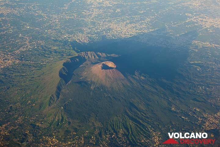 Vesuvius volcano near Naples, Italy, seen from the air. The rim of the remnant of the older Somma volcano which collapsed in the 79 AD Plinian eruption is clearly visible to the left of the new Cono Grande cone with its crater. (Photo: Tom Pfeiffer)