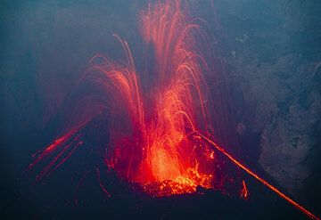 Strombolian explosion from the new cone inside Bocca Nuova crater of Etna volcano in Aug 2012 (Photo: Tom Pfeiffer)