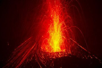 Strombolian eruption from the new cone inside the eastern vent of Bocca Nuova crater (Etna) on the evening of 5 Aug 2012. (Photo: Tom Pfeiffer)