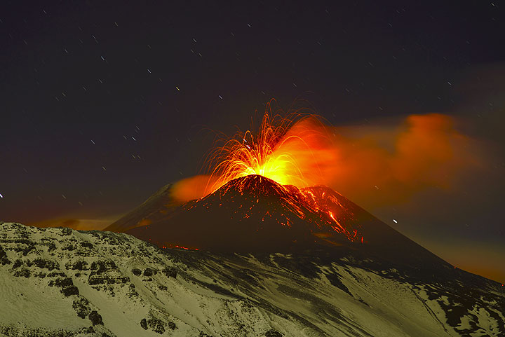 Explosion of a magma bubble and the headwall of the Valle del Bove in moonlight. (Photo: Tom Pfeiffer)
