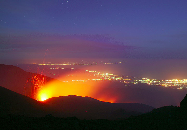 May 2008 flank eruption on the SE side of Etna, lights of Giarre and Taormina in background (Photo: Tom Pfeiffer)