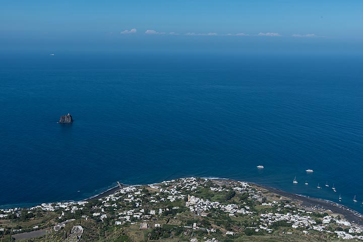 View down towards Stromboli village and the blue Tyrrhenian Sea; in the far background, the coast of Calabria can be seen to the east. (Photo: Tom Pfeiffer)