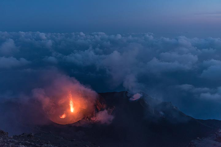 An eruption of the western crater at the late morning blue hour. (Photo: Tom Pfeiffer)