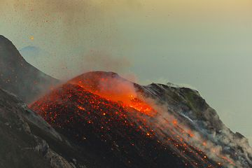 Glowing bombs remain scattered around the vent after the eruption is over. (Photo: Tom Pfeiffer)